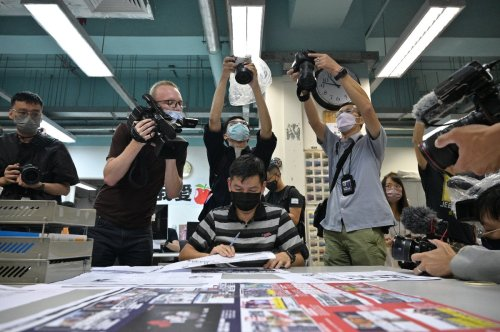 Hong Kong police detain three former Apple Daily editors under security law