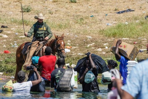 Uproar over mounted border agents turning back Haitian migrants