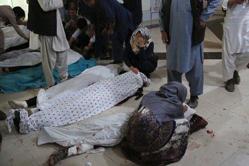 Afghans begin burying dead from bloody school blasts