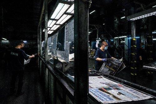 Hong Kong media reel as security law targets democracy paper's reporting