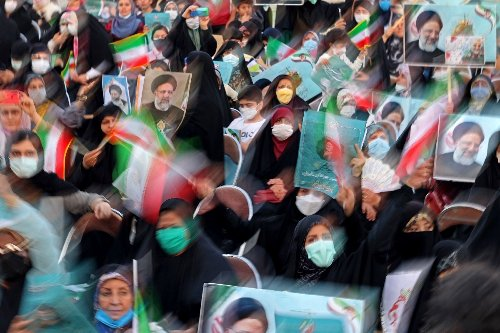 Iran ultraconservative headed for presidency as poll rivals pull out