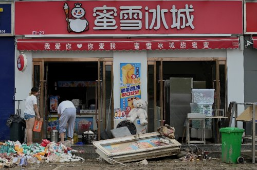 China braces for Typhoon In-Fa as it cleans up flood damage