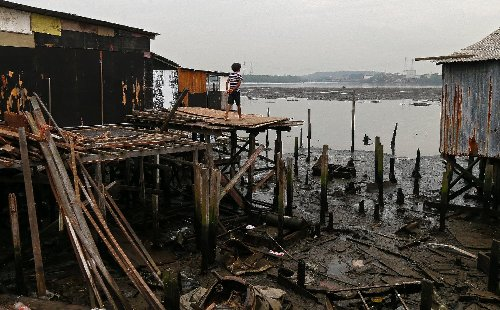 In Brazil favela on stilts, Covid one on a long list of woes