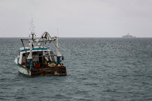 Britain, France send ships to Jersey as fishing spat deepens