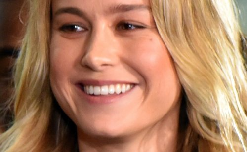 "Brie Larson Wows In Vintage White Lace Corset and Levi's, ""The Modern Bridgerton"""