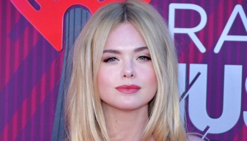"""Elle Fanning Is Absolutely Stunning In Tight Corset Dress, """"Breathless"""""""