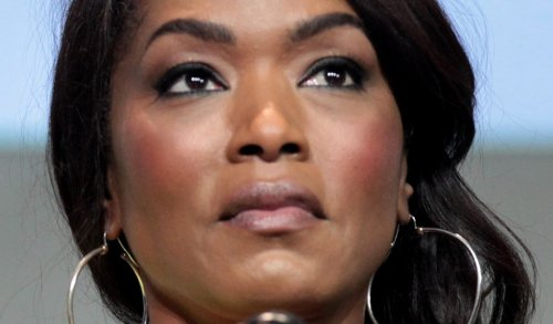 """Angela Bassett Wows In Candy-Striped Suit and Stilettos, """"Obsessed With This Look"""""""