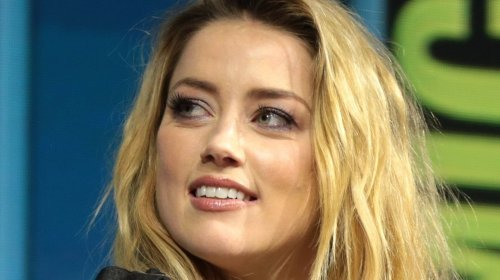 """Amber Heard Wows In Black Leather Pants, """"In a Committed Relationship…"""""""