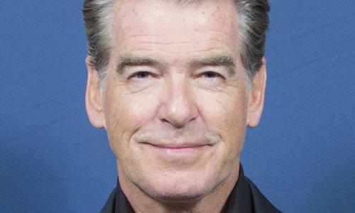 Pierce Brosnan, 68, Flaunts Amazing Abs, Blows Out Candles with Danny DeVito