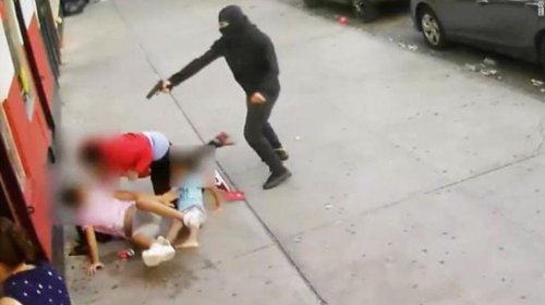 Disturbing moment two children are caught up in a terrifying shooting in New York