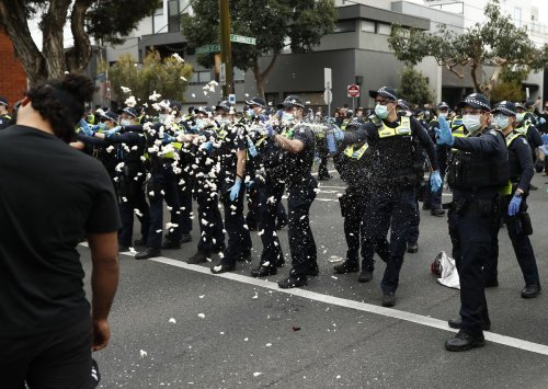 Melbourne protest in Richmond sees THOUSANDS of anti-lockdown protesters defy health orders and square off against police