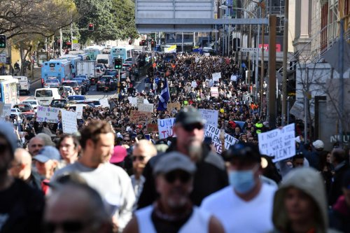 NSW COVID-19 cases rise by 210 as police prepare for protest