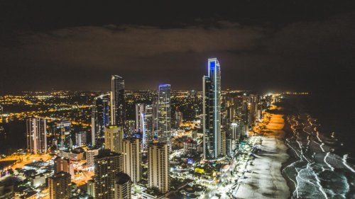 Teenager on Gold Coast rushed to hospital after falling EIGHT METRES from Surfers Paradise balcony