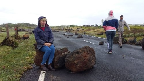 'Horrendous' seas whip huge boulders across roads, leave family stranded