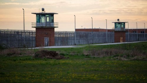 1 in 3 state prisoners tested positive for COVID-19, report says