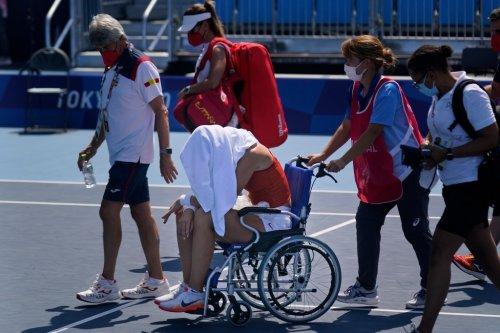 Tennis star leaves court in wheelchair amid 'brutal' Tokyo heat