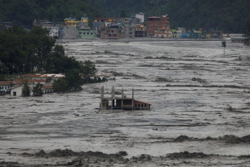Relentless monsoon rainfall produces deadly flooding in Bhutan, forces dramatic rescues in Nepal