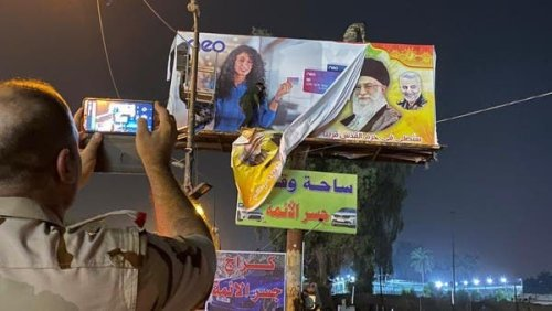 Baghdad residents celebrate removal of Iran's Khomeini, Soleimani billboards