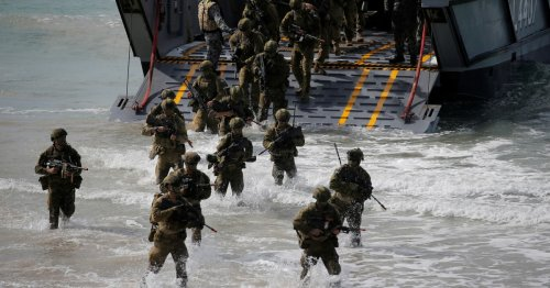 Australia to upgrade military bases, expand war games with US