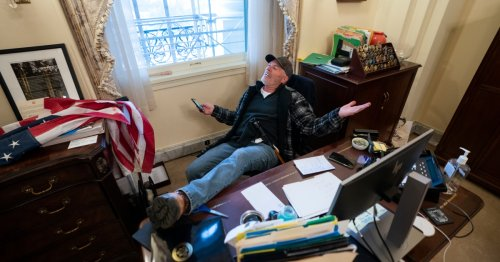 Man who put feet on Pelosi's desk during US Capitol riot released