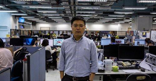 Hong Kong police arrest Apple Daily editor, directors, block HQ