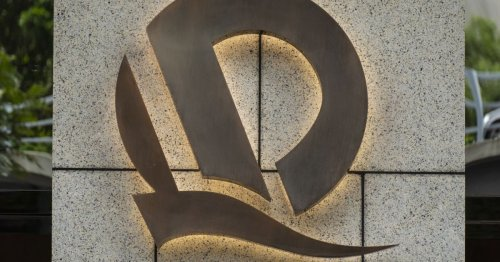 China pumps $14bn in cash into market amid Evergrande crisis