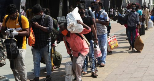 India: migrant workers leave cities as COVID measures bite