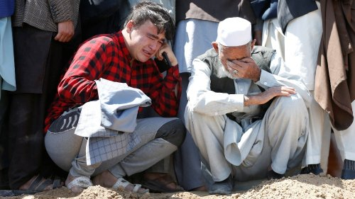 Grief and anger after deadly blasts target Afghan school