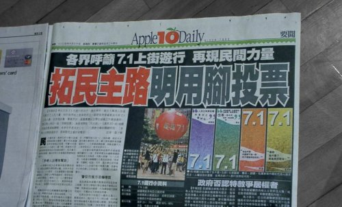 Hong Kong police raid Apple Daily newspaper, arrest executives over calls for sanctions