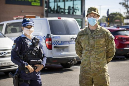 Australia deploys helicopters, hundreds of troops to keep people at home in strict new lockdowns in Sydney