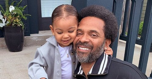 Mustached Mike Epps Holds Baby Indiana Dressed in Floral Swimsuit – Fans Say She Is Model & He Resembles Richard Pryor