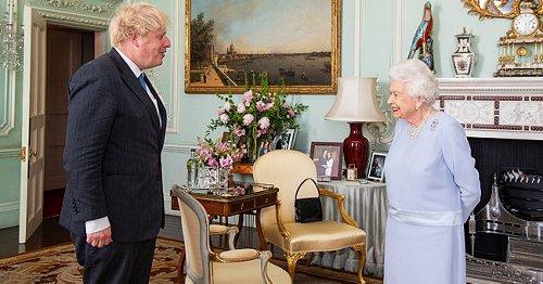 Queen Elizabeth Keeps Photo of Meghan & Harry at Buckingham Palace Amid Royal Rift