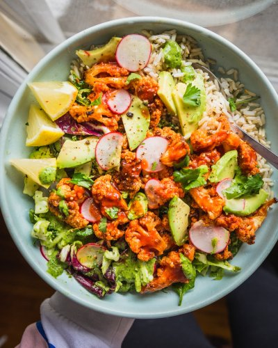 Spicy Buffalo Cauliflower Bowls with Avocado and Green Tahini