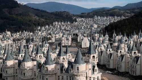 Haunting Photos Reveal a Massive Abandoned Town of Disneyesque Castles