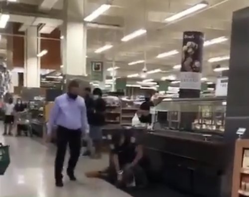 Miami Cop on Leave After Video Captures Him Pounding on Homeless Black Man Who'd Been Accused of Stealing Food In Publix: 'I'm Not Resisting You!'