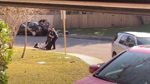 Texas Officer Who Issued Bogus Misdemeanor to Black Man for Not Showing ID Seen Dragging Him Down the Street In New Footage