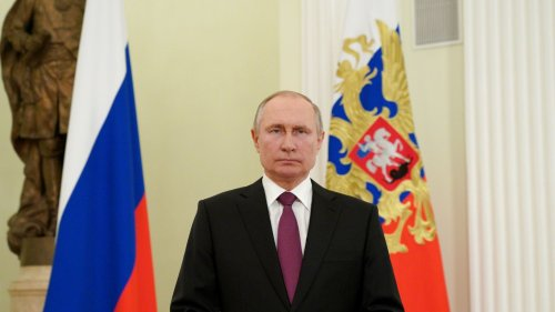 Putin signs law that would let him stay in power until 2036