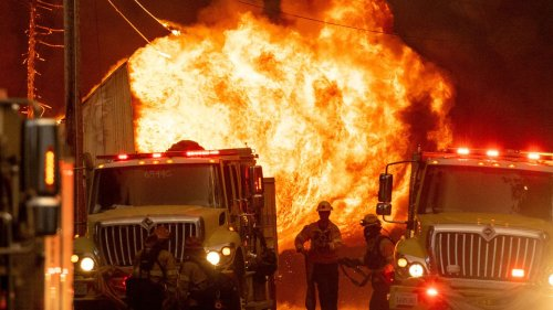 California wildfire explodes in size, destroys historic town