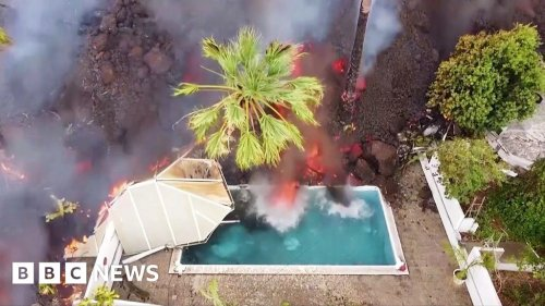 Lava from La Palma volcano engulfs homes and pools