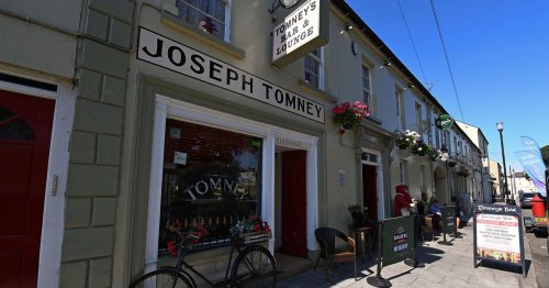 Tomney's Bar accept Ulster Pub of the Year award in memory of late team member