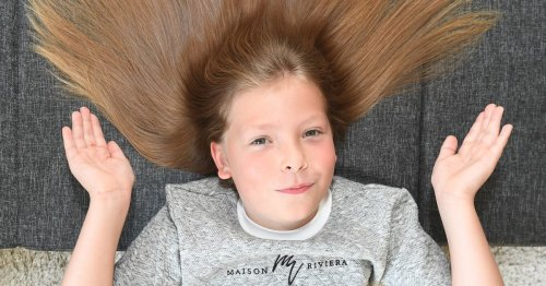 Schoolboy defies bullies and grows hair for years to help child with cancer