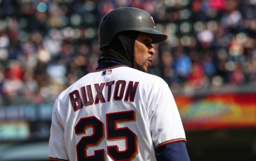 Red Sox out-slug Twins in chilly matinee