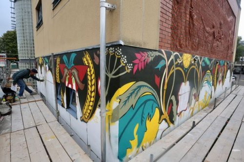 Murals painted to encourage people to take less polluted route