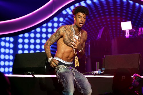 Rapper Blueface Gets Compared To R.Kelly After Video Shows Women Living In His Home Sleeping On Bunk Beds And Getting Tattoos Of His Logo
