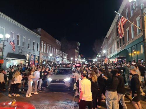 Ohio University Went Buck Wild, Crowd Surfed On Court Street To Celebrate The School's March Madness Upset Win