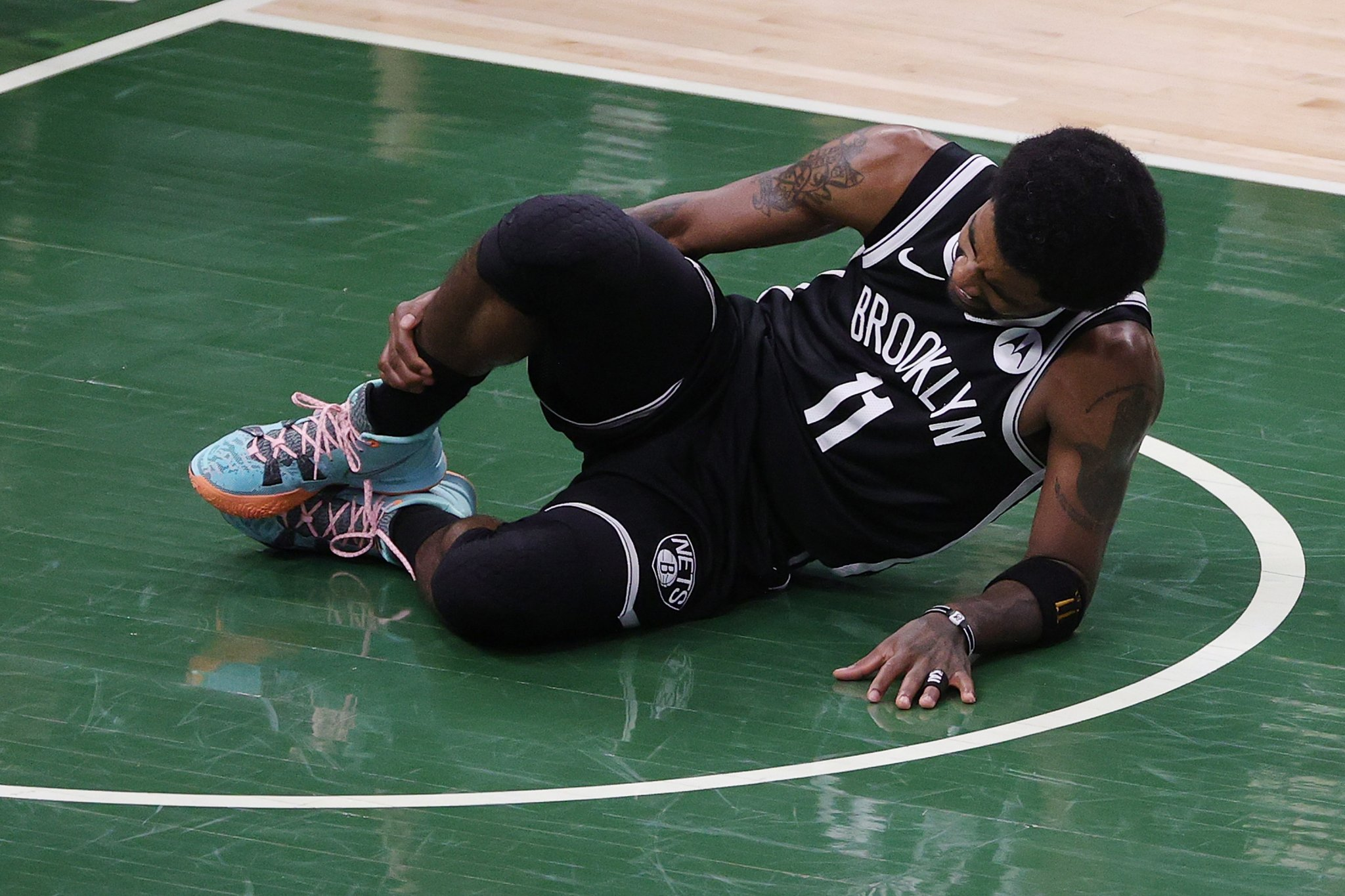 Kyrie's ankle injury has players claiming 'karma' and calling Giannis dirty - cover