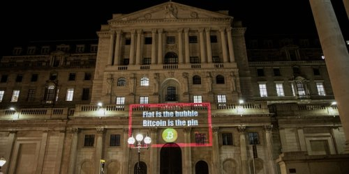 An anonymous crypto advocate projected messages championing bitcoin on the walls of the Bank of England and the UK Parliament