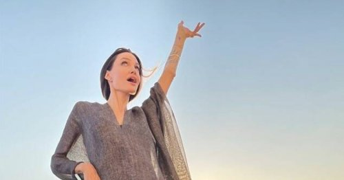 Angelina Jolie Staged a Carefree Rooftop Photo Shoot With Artists