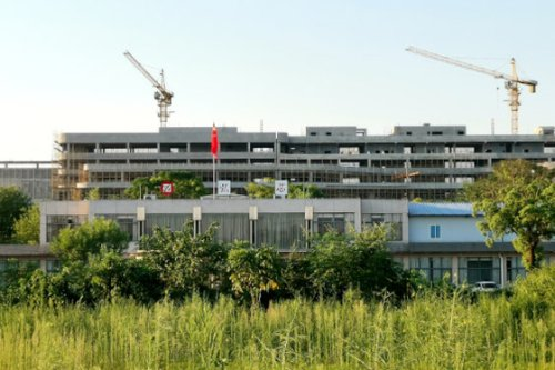Exclusive: Idle Cranes, Unfinished Buildings Are All That's Left in China's Former Field of Chip Dreams