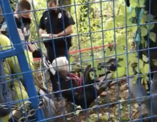 RCMP carry away elderly TMX protester in Burnaby (BC)